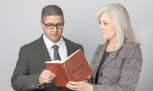 Woman and man reviewing journal entry