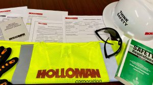 Safety documents with gloves and hard hat